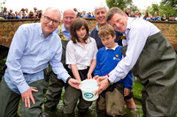L-R) Steve Robertson (CEO, Thames Water); Richard Clarke (ARK, Chairman); Martin Salter (Angling Trust); Richard Benyon MP and children from Ramsbury Primary School