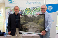 Thames Water CEO Steve Robertson is presented with a framed photograph of the Kennet by ARK